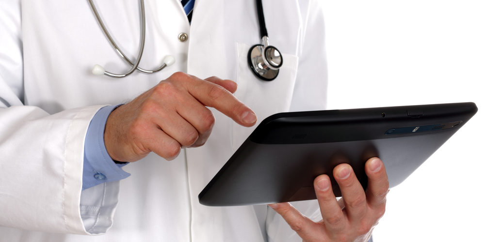 doctor with tablet device